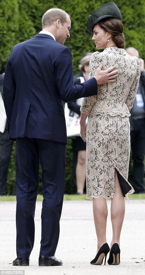 The Duke put an affectionate hand on his wife's shoulder as they make their way towards th...