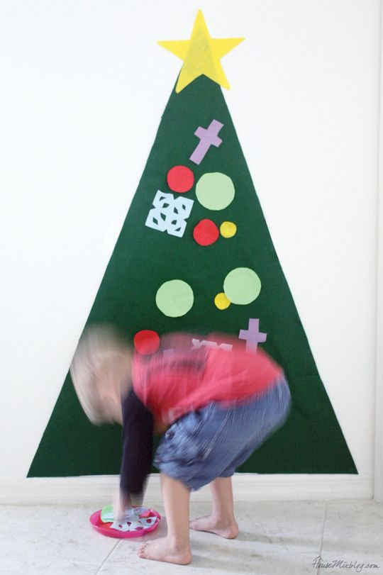 Have you seen these felt Christmas trees for kids? I made it mostly for Clara, but the boys are actually playing with it more. I am really, truly surprised because I had zero expectations. For the tree, I bought a yard of green felt for $3 at Hobby Lobby (after online coupon), and used about five sheets of 8.5x11 felt I had in my fabric drawer for the ornaments. I hung the green triangle on the wall with command strips and postal tape. I'm waiting for the little one to rip it off the wall…
