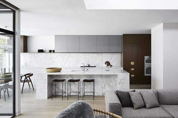A Melbourne Midcentury Gets a Palm Springs-Inspired Revival - Dwell #palmsprings #kitchen #marble #modernkitchens