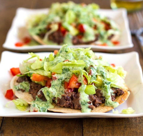 Healthy Black Bean Tostadas with Cilantro Sauce: Behold a vegetarian baked tostada for a Taco Tuesday party. Invite your friends; this veggie- and bean-filled dish is an easy hit with a crowd! This recipe does contain lactose in the sauce, but the live and active cultures in yogurt help with digestion, making it a friendly option to those who are lactose intolerant.