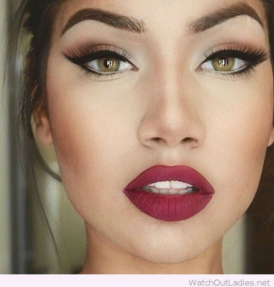 Green eyes, big red lips and updo