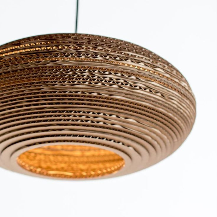 Large oval hanging lampshade made from recycled cardboard -therefore light but strong and the layers of cardboard look like wood The oval mimics the