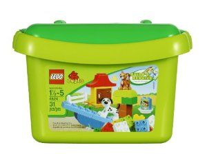 LEGO DUPLO 4624 Brick Box by LEGO. $14.10. Contains 31 elements. Sturdy, reusable LEGO brick storage box also included. Features brown cat, white dog, food carton, plate, flowers, wood-effect window, fence and assorted shaped bricks and basic DUPLO bricks. Enhance creative play with the enclosed idea booklet. From the Manufacturer                This great starter set is the perfect introduction to the world of LEGO DUPLO. The assortment of cute cat-and-dog-theme ...