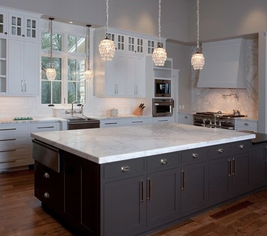 "taj mahal quartzite kitchen islands | 108"" The granite has a bush hammered finish"