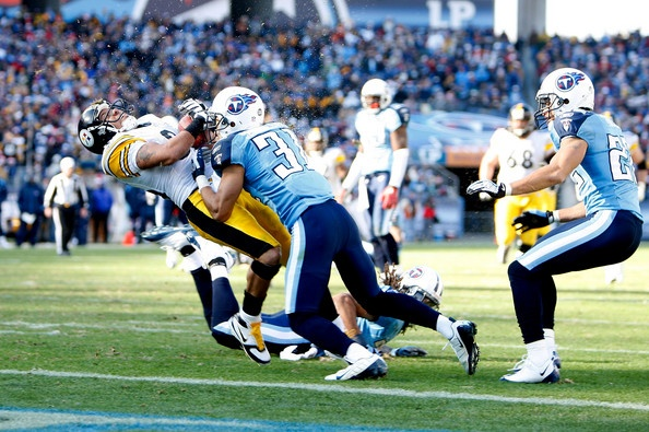 Former Tennessee Titans CB Cortland Finnegan (31) delivers a jarring hit on Former Pittsburgh Steelers WR Hines Ward (86) .. who got the touchdown anyway.