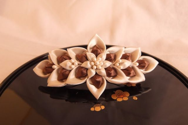 It made the hair ornaments in satin.milk chocolate flower.