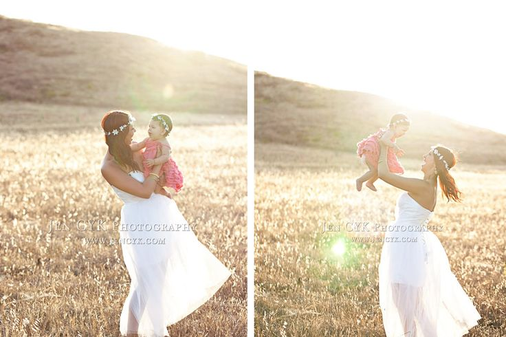 Mother and baby daughter photography in a field.  Beautiful dreamy light.