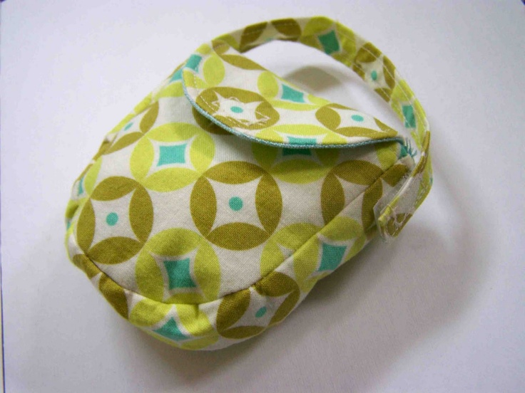 "New baby gift?  Another pinner said ""Made by Me. Shared with you.: Sewing for Baby: The Pacifier Pocket"". Or pocket for small bits and pieces."