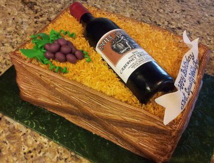 1/4 sheet 2 layer cake frosted with Pastry Pride and airbrushed brown. Toasted coconut was added. The bottle was shaped from a real wine bottle using dark green gumpaste. Once dry, I painted it with brown airbrush color and added an edible image label.