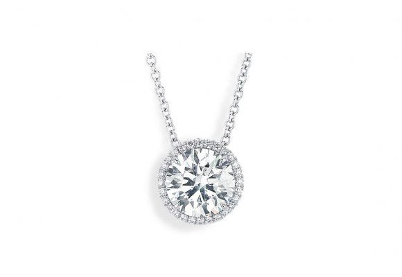 Center of My Universe™ Halo Pendant ~ This modern classic solitaire pendant features a 3.04 round Forevermark diamond center surrounded by 0.16 carats of round melee diamonds set in 18K white gold