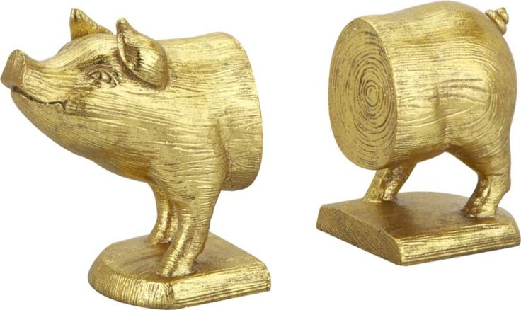 gold pig bookends set of 2  | CB2 (not for me... but I have someone in mind... bwahahaha!)