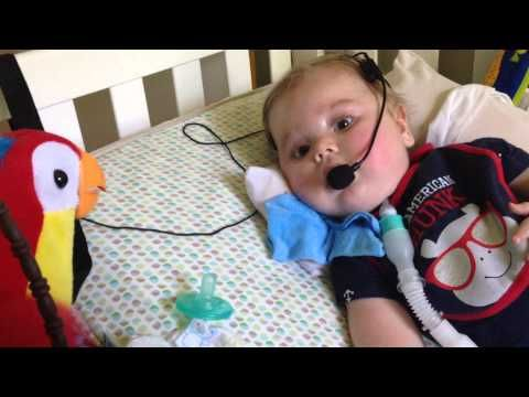 Max using Passy Muir Valve to talk with Pete the Repeat Parrot - YouTube