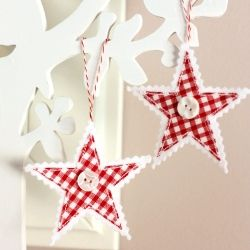 Christmas stars ornaments made of felt, gingham, buttons, and twine.