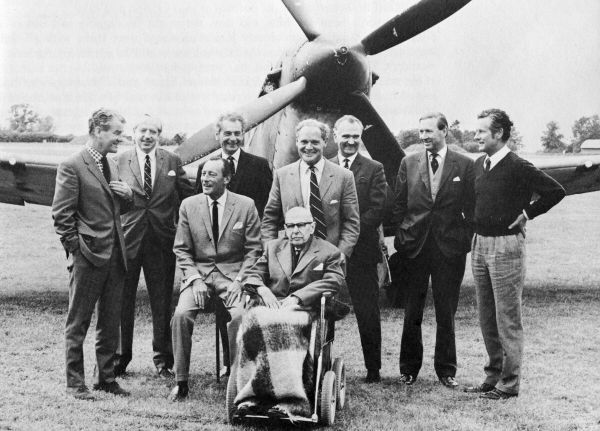 "The air aces of 1940 with Lord Dowding visiting the film set of ""The Battle of Britain"". From left to right: Al Deere, Tom Gleave, Robert  Stanford Tuck (seated), Boleslaw Drobinski, Douglas Bader, Ludwik Martell, Johnnie Kent, Peter Townsend,  Lord Dowding (in wheelchair)."