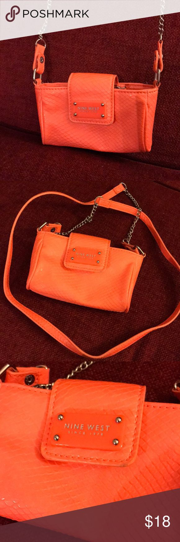 Nine West small neon orange purse crossbody Orange strap with partial chain strap. Neon orange Nine West purse. Inside has zipper divider. Small purse. Crossbody. Closes with button clasp. ID holder on back side. Nine West Bags Crossbody Bags