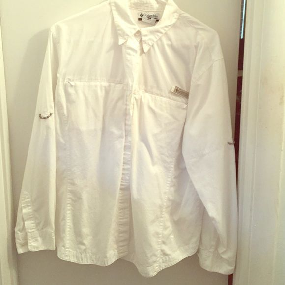 White Columbia fishing shirt for women White button down Columbia fishing shirt. Very light comfortable fabric. Velcro to keep collar down. Two front breast pockets with plastic zippers and mesh lining. Top of shirt mesh lined as well. Columbia Tops Button Down Shirts