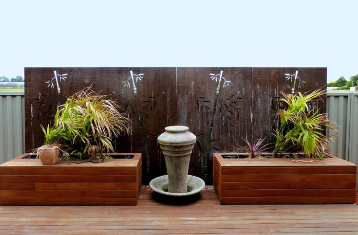 This patio is given an Oriental touch with the simple installation of compressed hardwood QAQ decorative 'Bamboo' panels along the center patio fence area.