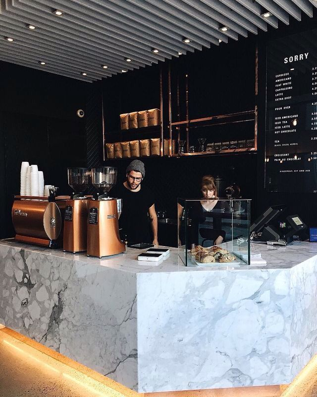 Bronze LaMarzocco espresso machine + beautiful coffee shop layout