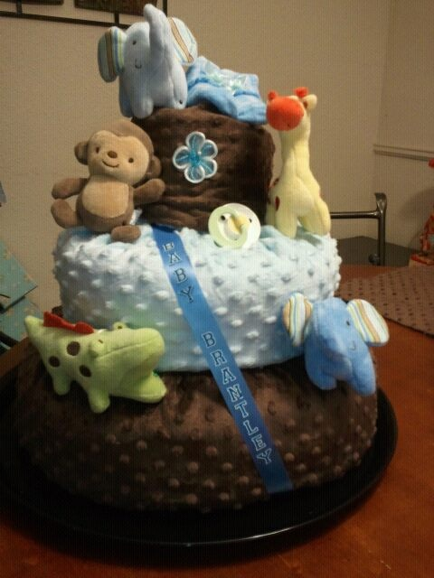 Diaper Cake, Included Champagne, diapers, crib blanket, receiving blanket and burping pads, booties, animal mobile fo the crib & pacifiers
