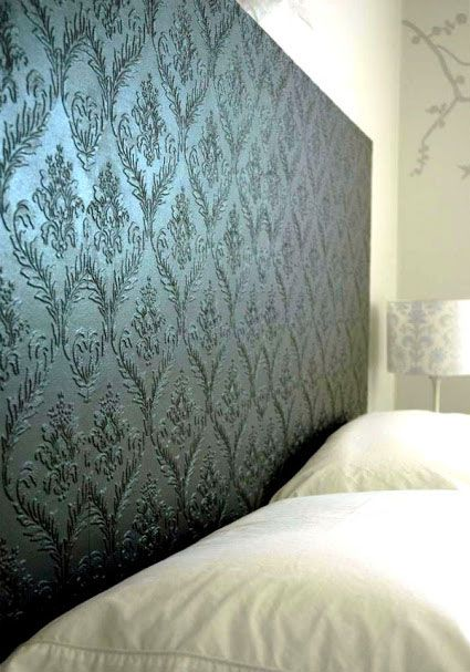 DIY Headboards: Creating a beautiful headboard is easy. Cover a plain hollow-core door with paintable embossed wallpaper and then paint it out. Voila! You have a beautiful headboard. Embossed Wallpaper Headboard Tutorial