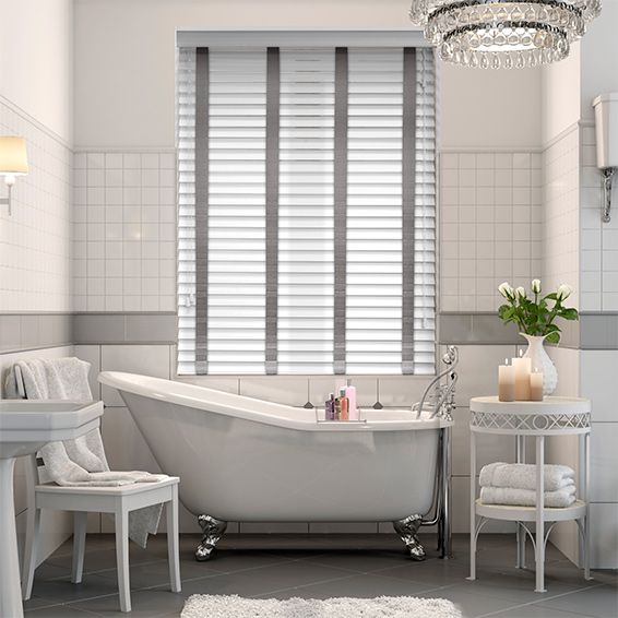 This Arctic White faux wood blind with soft Paloma tapes brings a wonderful modern touch to any room. Its colourway is fresh and crisp and carries the detail beautifully.