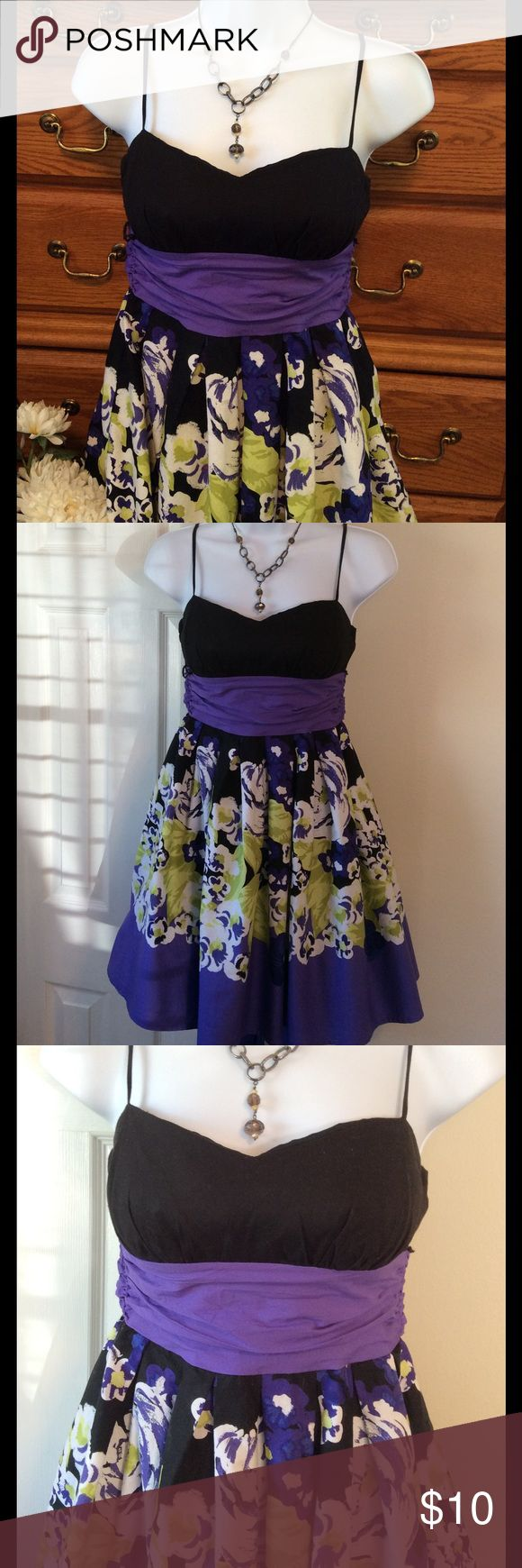 """B. Smart Purple Dress 97% cotton and 3% spandex.  Used but good condition.  Needs iron touch up!  Colors are purple, black , and shades of green.  Approximately 31"""" in length and when measured from armpit to armpit it is 14"""" across.  Has an elastic bust.  Zipper in the back along with a big tie. Tulle, puffy underskirt.  Size says 5/6. Lining 100% acetate.  Machine wash cold. B. Smart Dresses Casual"""