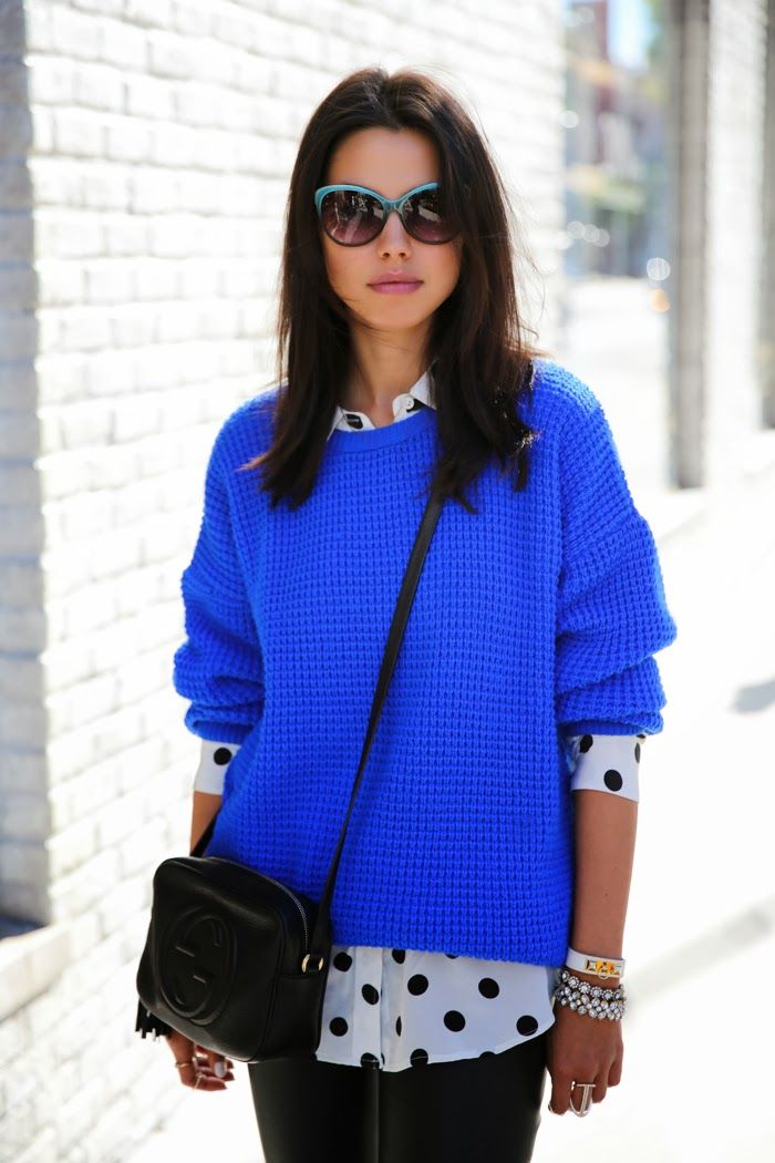 Wow, love the bright neon blue sweater, layered over a fun polka doted dress shirt.