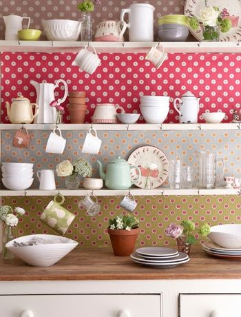 Different wallpaper at the back of each shelf:-)