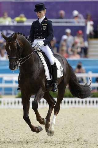 Helen Langehanenberg of Germany rides her horse Damon Hill during the equestrian dressage competition at the 2012 Summer Olympics Aug. 3.