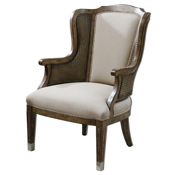 Изящное и по-домашнему уютное кресло будет чудесно смотерться как в гостиной, так и на лоджии или в любой другой комнате. Мягкая обивка кресла - искусственная овчина, а деревянная основа- древесина тополя. Высота сиденья 48см.             Метки: Кресла для дома, Кресла с высокой спинкой, Кресла с деревянными подлокотниками, Кресло для отдыха.              Материал: Ткань, Дерево.              Бренд: Uttermost.              Стили: Классика и неоклассика.              Цвета: Светло-серый…