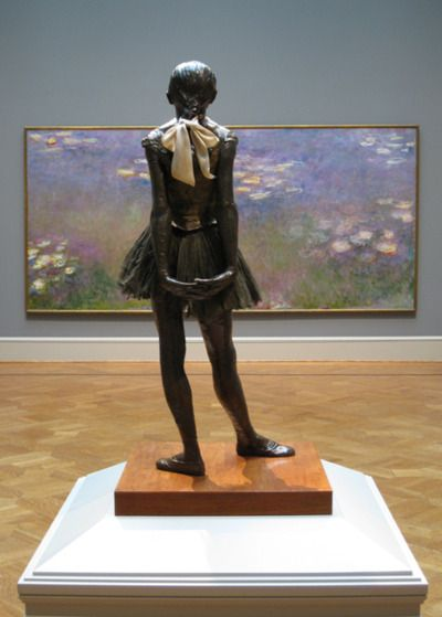 Degas sculpture in front of a Monet Painting.