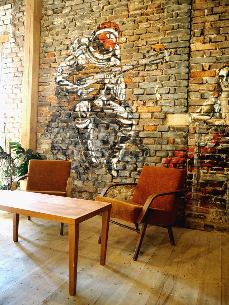 SPOTTED BY @soffamag | #soffa #soffamag #kavarnacohledajmeno #cafe #coffeehouse #Prague #bricks #industrial #urban #street #minimalism #minimalistic #design #interior #wood #wall #graffiti