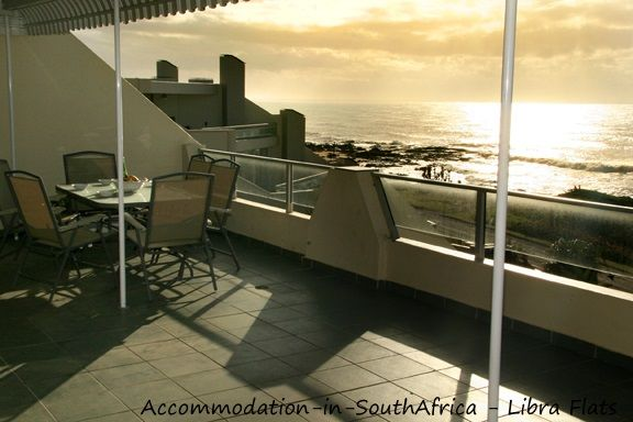 Relax on the patio Libra Flats. Accommodation at Libra Flats. Margate accommodation. Accommodation in Margate.