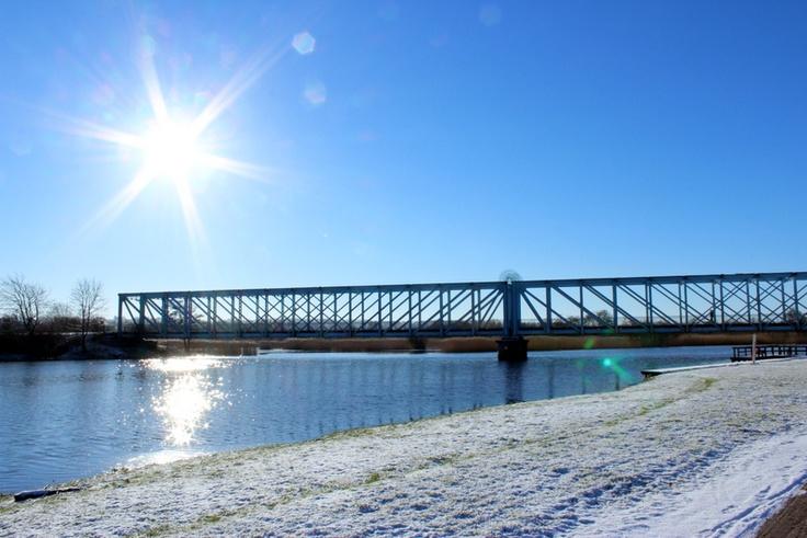 Blue bridge crossing Gudenaaen in Randers, Denmark.
