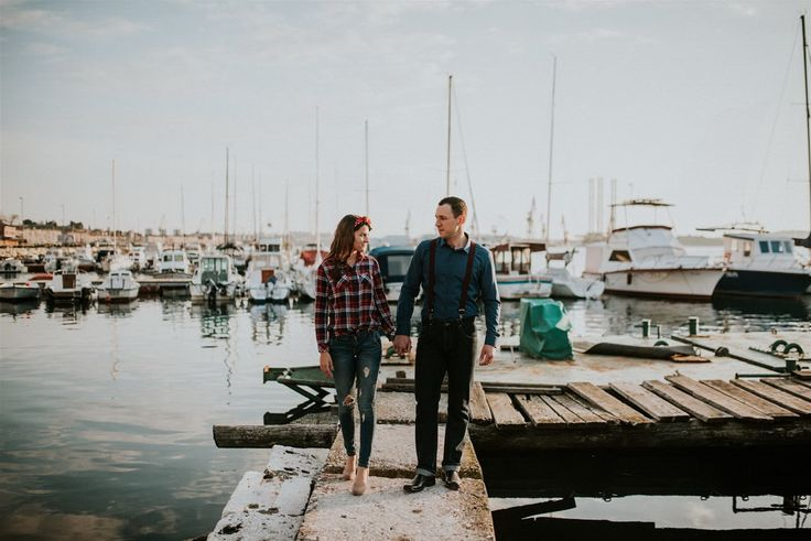 Moving to the docks and the water is a great background as they walk hand in hand.