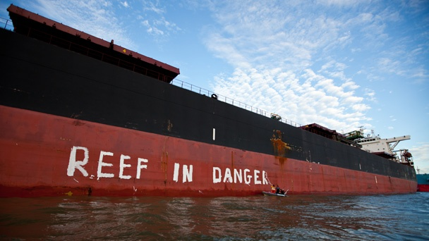Greenpeace activists painted the message on a huge coal ship moored at Gladstone QLD today, as UNESCO investigators arrived to inspect the harbour. The World Heritage custodians have arrived in Australia concerned about gas developments on the reef. Environmentalists are making sure they also consider the enormous threats to the reef by the coal expansion plans.