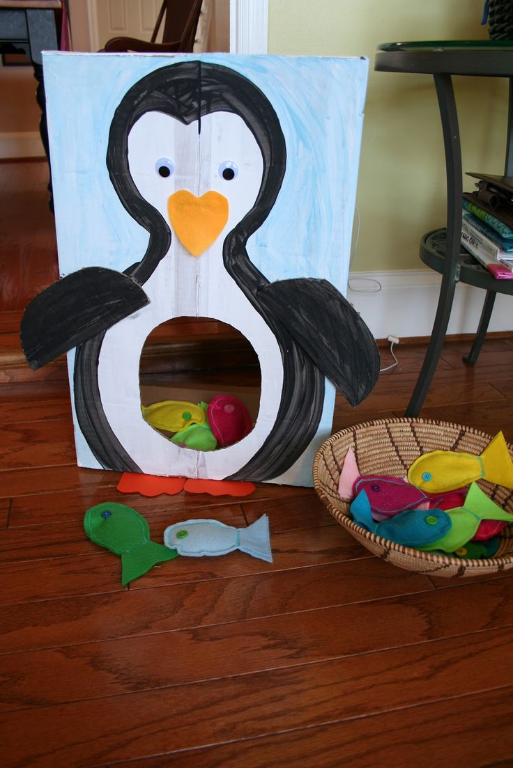 Cardboard Penguin Toss Game and Fish Bean Bags.  Beach party entertainment -- toss the fish in the seagulls mouth or crab's claw.  Or darts at the octopus tentacles.