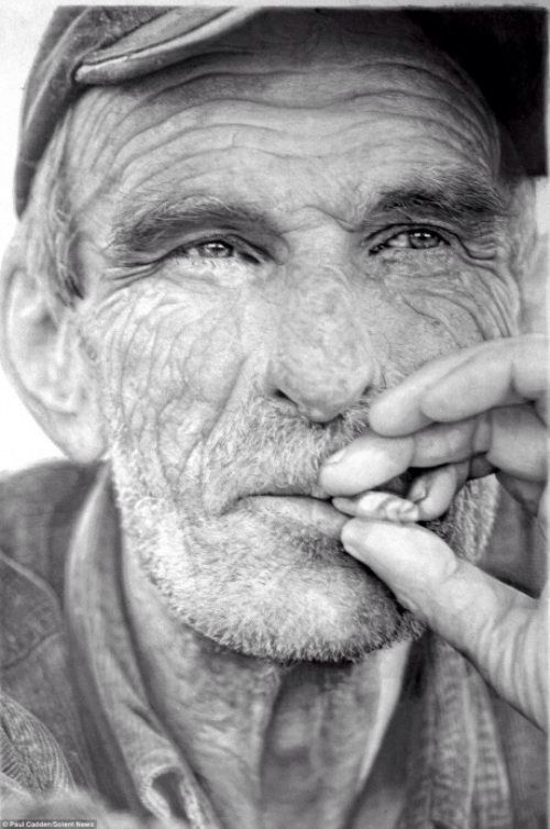 Amazingly this is a hand drawn picture in pencil by artist paul cadden he is a hyperrealist artist and does many pictures that look like standard black