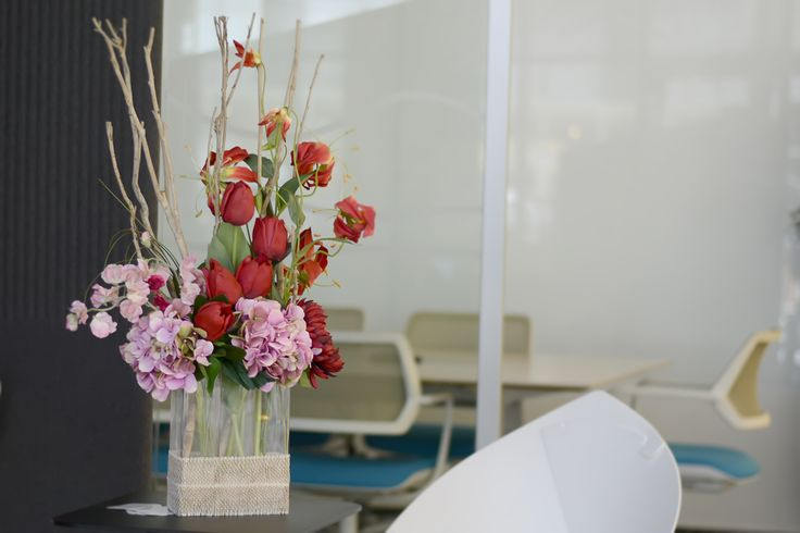 Pink hydrangea, red tulips and Gloriosa lily.