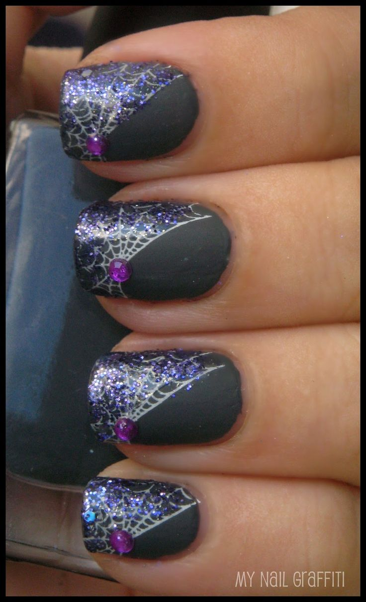 Halloween. Nail Art. Spiderweb nails with purple glitter and gemstones