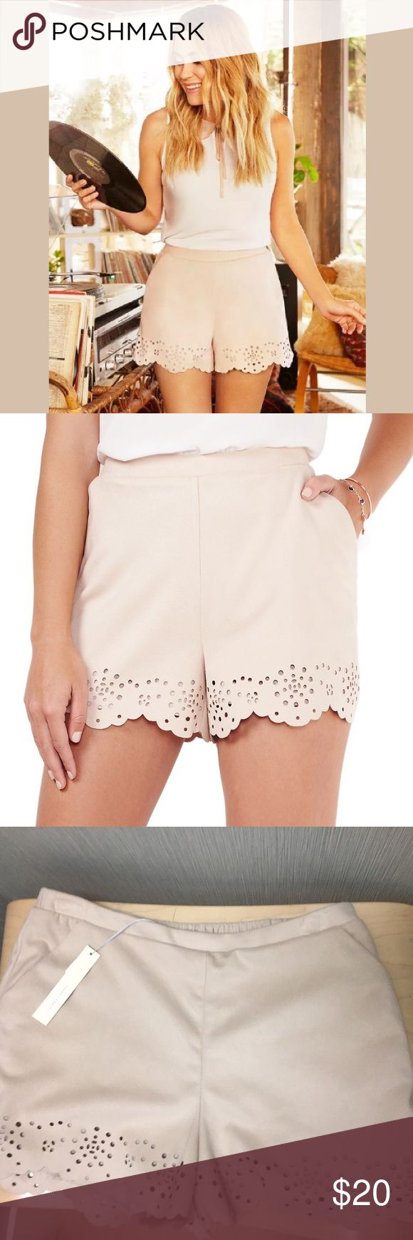 New LC Lauren Conrad Faux Suede Eyelet Shorts The scalloped eyelet hem adds a sophisticated touch to your casual style. In Natural Blush. New with tags! PRODUCT FEATURES Scalloped hem with eyelet details 2-pocket Faux-suede construction Lined LC Lauren Conrad Shorts