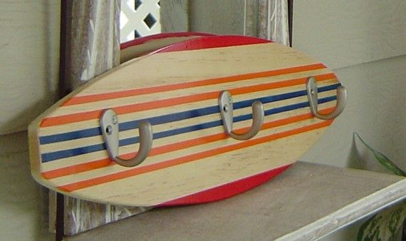 I really liked this idea of taking a surf board and putting hooks on it to make it a towel rack!