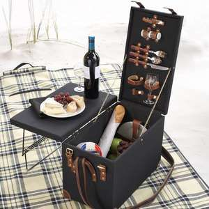 Retro Picnic Trunk. Pack up the ultimate picnic into this Picnic Trunk. Comes complete with place settings for two, ample space for food and beverages, and a handy built-in table top. The trunk comes complete with table setting for two (2 forks, 2 knives, 2 spoons, 2 porcelain plates, cork/bottle opener, salt/pepper shaker, and 2 wine glasses). The Side table flips up for ample dining space. A strap is provided for easy carrying.