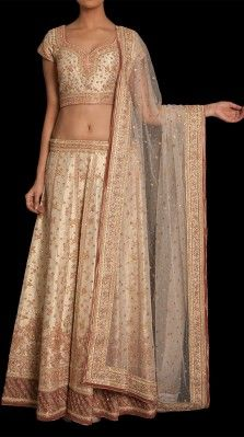 An offwhite/ pink heavy zardozi embroidered lehnga in brocade with a matching dupatta<br />