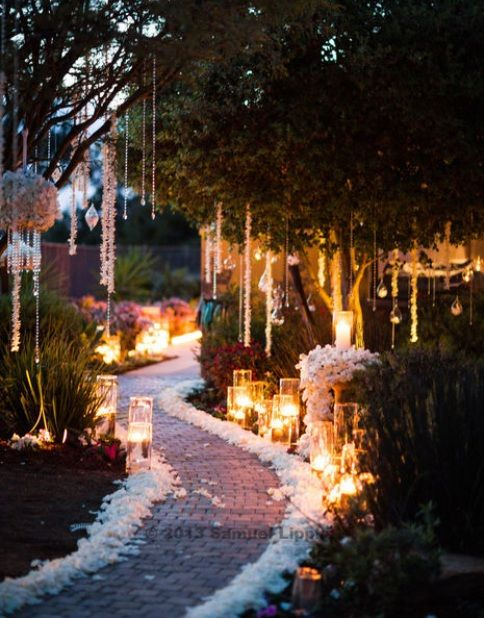 Candle lit garden wedding ceremony aisle. Flowers and candles by Adorations Botanical Artistry. Photo by Samuel Lippke Studios. Stephanie Rose Events