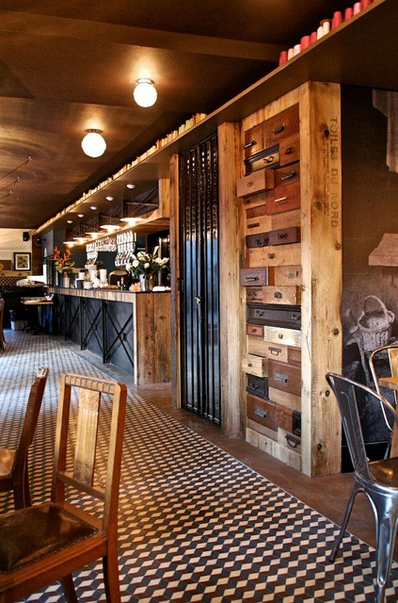 This is awesome, the wood warms and the concrete keeps it cool! Kaper Design; Restaurant & Hospitality Design: La Corde a Linge