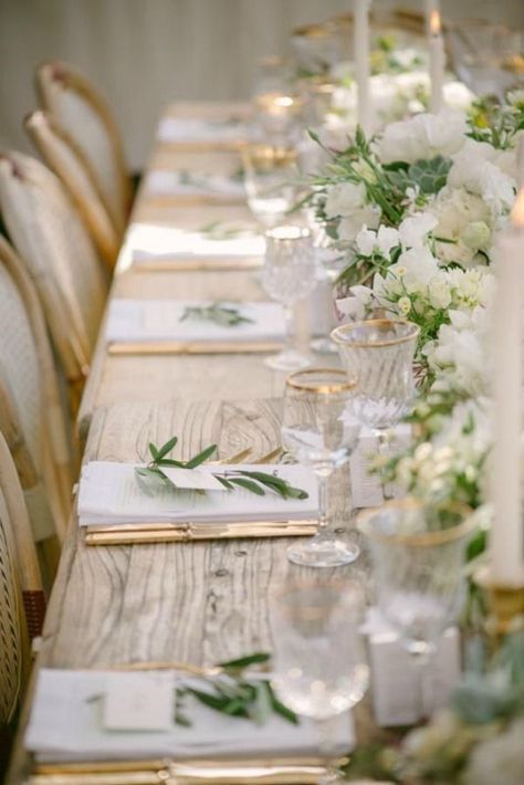 Green, gold, and white wedding reception table accents