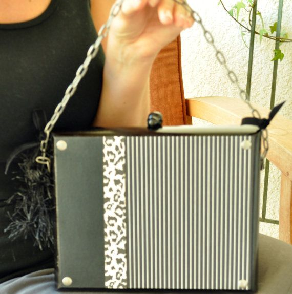 Black and white cigar box purse with cheetah print, pinstripes, and chain handle.
