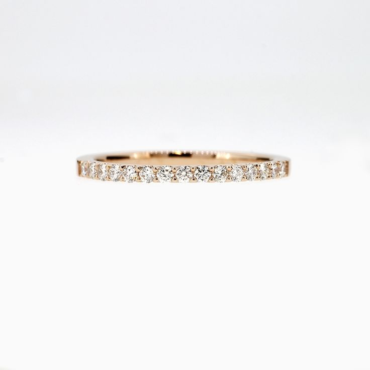 Size 6.25, one of a kind Rose gold eternity band with diamonds
