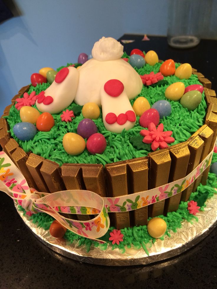 "Easter bunny Kitkat cake.  Can try this with chocolate frosting and the ""grass tip"" for the green frosting....just need to buy candy eggs then!"